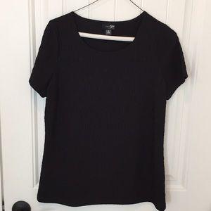Short sleeve black pullover top.